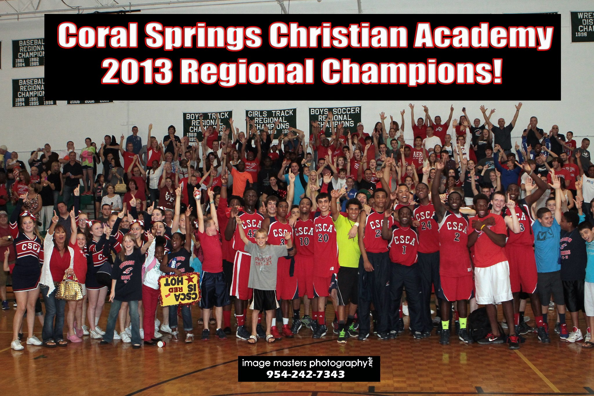 Athletics_Photo_2012_2013_Boys_Basketball_Varsity_Regional_Champions_With_Banner